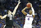 Kansas guard Devonte' Graham (4) puts up a three over Purdue guard Dakota Mathias (31) during the first half, Thursday, March 23, 2017 at Sprint Center in Kansas City, Mo.