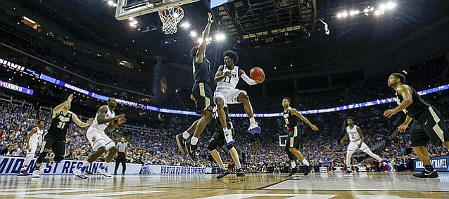 Kansas guard Josh Jackson (11) looks to pass while defended by Purdue forward Vince Edwards (12) during the second half, Thursday, March 23, 2017 at Sprint Center in Kansas City, Mo.