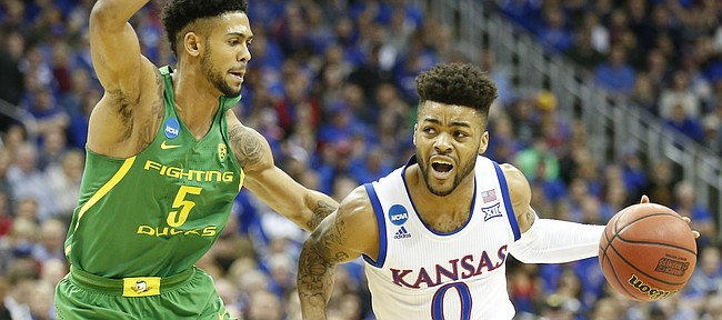 Kansas guard Frank Mason III (0) drives against Oregon guard Tyler Dorsey (5) during the first half on Saturday, March 25, 2017 at Sprint Center.