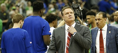 Kansas head coach Bill Self adjusts his tie as he leaves the court following the Jayhawks' 74-60 loss to Oregon on Saturday, March 25, 2017 at Sprint Center.