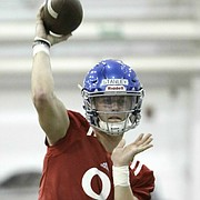 The competition this spring for the starting quarterback job at Kansas is tight. So much so that head coach David Beaty rarely sings the praises of either Carter Stanley (No. 9) or Peyton Bender (No. 7) on their own, without mentioning the other.
