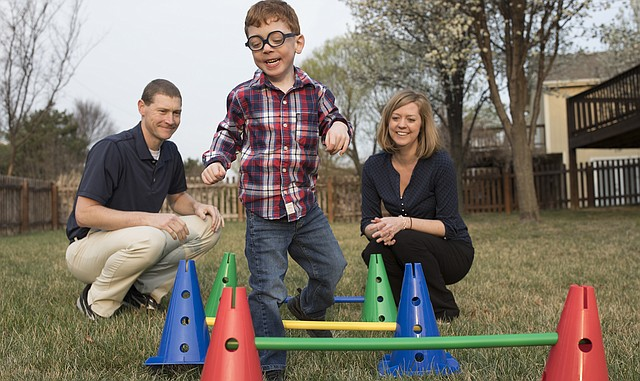 Adam and Rachel Rolf, two of the Lawrence-Douglas County Health Department's 2017 Health Champions, watch their son JJ play.
