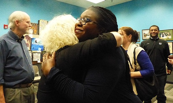 Melissa Johnson, right, receives a congratulatory hug from Margaret Weisbrod Morris, left, after being unanimously appointed to the Lawrence school board on Monday, March 27. Both were candidates for the seat vacated by Kristie Adair last month.