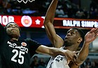 Big East's Lonnie Walker IV, left, drives to the basket against Big West's Billy Preston during the second half of the McDonald's All-American boys high school basketball game Wednesday in Chicago. Big West won 109-107.