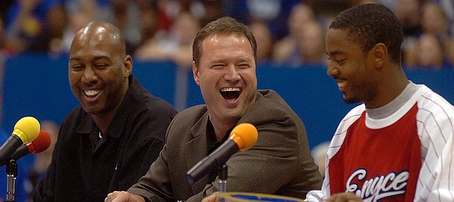 From left, men's basketball dance judges Danny Manning, Bill Self and Aaron Miles crack jokes while giving scores to members of the men's basketball team skits during Late Night at Allen Fieldhouse on Oct. 13, 2006.