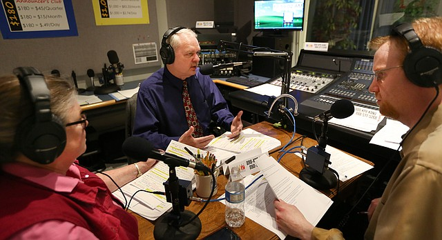 Dan Skinner, director of Kansas Public Radio, center, is flanked by volunteer Tana Ahlen, Eudora, left, and KPR music director Michael Keelan, as the three ask listeners for contributions during the station's Campaign for Excellence on Friday, March 31, 2017 at the KANU studio.