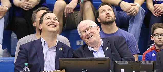 Broadcaster Bob Davis laughs next to Greg Gurley during a video commemorating Davis' 37-year during halftime, Saturday, March 5, 2016 at Allen Fieldhouse.
