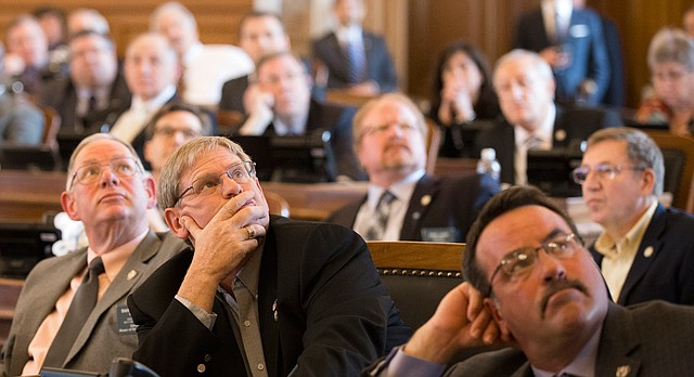 House Republicans watch the voting board on the Kansas House floor during an open vote on overriding Gov. Sam Brownback's veto of a Medicaid expansion bill, Monday, April 3, 2017 at the Kansas Statehouse in Topeka. The measure failed by three votes.