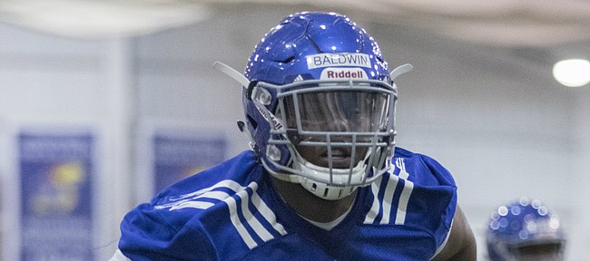 A transfer from Alabama, offensive lineman Charles Baldwin sat out the 2016 season at Kansas. This spring, the 6-foot-5, 305-pound junior right tackle finally gets to practice with the first-stringers on offense, as the Jayhawks begin preparation for the 2017 season.