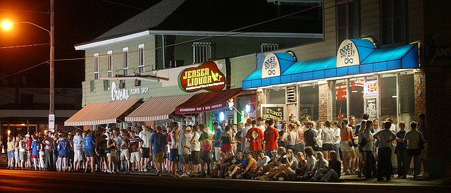 Students from University of Kansas scholarship halls wait for doughnuts outside Joe's Bakery, 616 W. Ninth St., in this file photo from 2003.