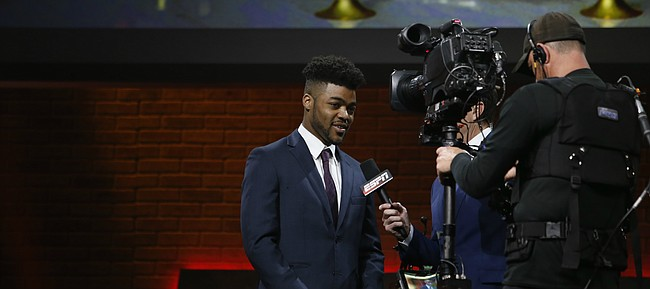 Kansas senior Frank Mason III is interviewed by ESPN's Rece Davis live on ESPN2 shortly after winning the 2017 John R. Wooden national player of the year award at a ceremony Friday, April 7, 2017 in downtown Los Angeles.