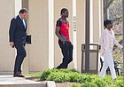 University of Kansas basketball player Josh Jackson leaves the Douglas County Courthouse with his counsel and his mother, Apples Jones, following his arraignment in a criminal damage case on Wednesday, April 12, 2017.