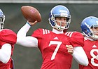 Kansas quarterback Peyton Bender throws between Tyriek Starks, left, and Keaton Perry during spring football practice on Thursday, March 30, 2017.