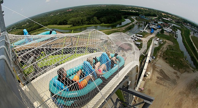 "In this July 9, 2014, file photo, riders go down the water slide called ""Verruckt"" at Schlitterbahn Waterpark in Kansas City, Kan. (AP Photo/Charlie Riedel, File)"