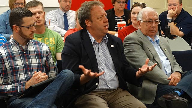 Rep. John Wilson, right, Sen. Tom Holland and Rep. Jim Karleskint update the Eudora school board Thursday about progress on education and other issues in the 2017 legislative session.