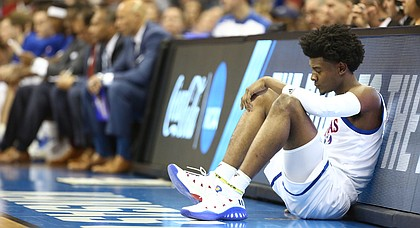 Kansas guard Josh Jackson (11) waits to check back into the game after sitting with two early fouls during the first half on Saturday, March 25, 2017 at Sprint Center.