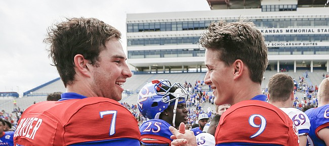 Competing quarterbacks Team Jayhawk quarterback Peyton Bender (7) and Team KU quarterback Carter Stanley (9) shake hands after the 2017 Spring Game on Saturday, April 15 at Memorial Stadium.