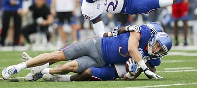 Team KU wide receiver Chase Harrell (3) takes Team Jayhawks safety Emmanuel Moore (20) off of his feet after a catch during the first quarter of the 2017 Spring Game on Saturday, April 15 at Memorial Stadium.