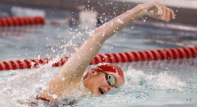 Lawrence High's Morgan Jones swims to a first place finish during the final heat of the Girls 200 Yard Freestyle event on Tuesday, April 18, 2017 at Lawrence High School.