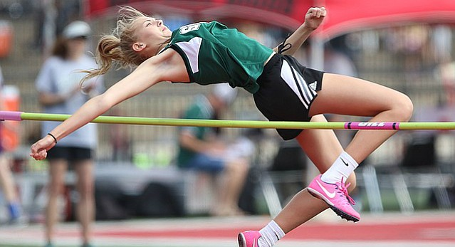 Free State high jumper Bella Crawford-Parker clears the bar on an attempt, Wednesday, April 19, 2017 at Lawrence High School.