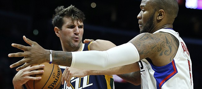 Utah Jazz center Jeff Withey (24) pulls away a rebound from Los Angeles Clippers center Marreese Speights (5) during the second half of an NBA preseason basketball game in Los Angeles, Monday, Oct. 10, 2016. The Jazz won 96-94. (AP Photo/Alex Gallardo)