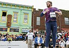 Reigning Olympic gold medalist and winner of the Downtown Shot Put Ryan Crouser jumps in the ring as he watches his final throw on Friday, April 21, 2017 at the intersection of Eighth and New Hampshire streets.