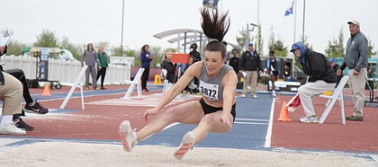 University of Kansas alumna and 2016 Olympian Andrea Geubelle competes in the college/open division of the women's triple at the KU Relays on Friday at Rock Chalk Park. Geubelle won the event with a mark of 13.73 meters.