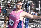 University of Kansas senior Mitch Cooper winds up to throw the discus at the KU Relays on Saturday at Rock Chalk Park. Cooper won the event with a throw of 61.77 meters (202 feet, 8 inches).