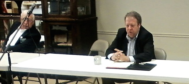 Baldwin City Democrat Tom Holland, right, explains a tax policy point when Jim Karleskint, R-Tonganoxie listens Saturday at a legislative town hall at the Tonganoxie VFW Post.