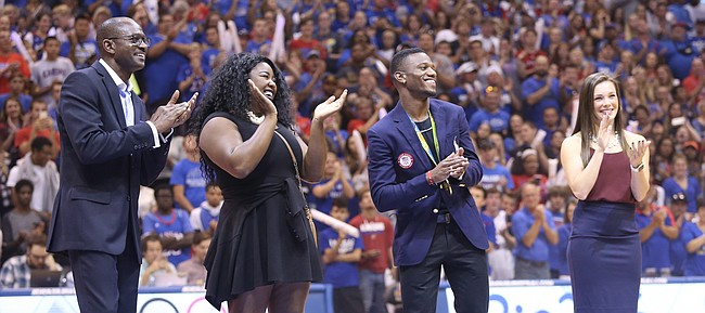 Kansas track and field coach Stanley Redwine, left, stands with 2016 Olympic athletes Daina Levy, Kyle Clemons and Andrea Geubelle as they are honored before the Fieldhouse during Late Night in the Phog on Saturday, Oct. 1, 2016.