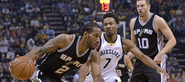 Memphis Grizzlies guard Wayne Selden Jr. (7) defends San Antonio forward Kawhi Leonard (2) as Spurs forward David Lee (10) moves for position during the second half of Game 4 in an NBA basketball first-round playoff series Saturday, April 22, 2017, in Memphis, Tenn.