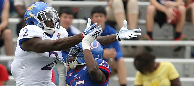 Team Jayhawks receiver Daylon Charlot has a pass broken up by Team KU cornerback Julian Chandler (25) during the first quarter of the 2017 Spring Game on Saturday, April 15 at Memorial Stadium.