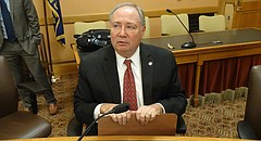 In this file photo from March 13, 2017, Sen. Jim Denning, R-Overland Park, talks with reporters at the Kansas Statehouse in Topeka.