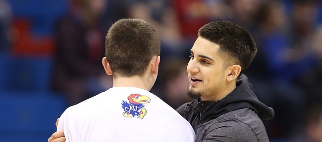 Kansas forward Mitch Lightfoot gets wrapped up by his newest team member Sam Cunliffe, a transfer from Arizona State prior to tipoff against Oklahoma State on Saturday, Jan. 14, 2017 at Allen Fieldhouse.