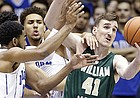 Duke's Chase Jeter, rear, Matt Jones, left, and William & Mary's Jack Whitman (41) reach for the ball during the first half of an NCAA college basketball game in Durham, N.C., Wednesday, Nov. 23, 2016.