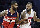 Washington Wizards forward Markieff Morris (5) defends Detroit Pistons forward Marcus Morris during the first half of an NBA basketball game, Friday, April 8, 2016, in Auburn Hills, Mich. (AP Photo/Carlos Osorio)