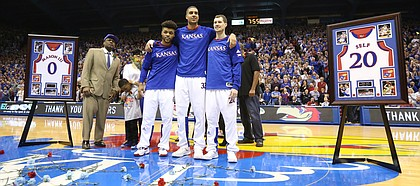 Kansas seniors Frank Mason III, left, Landen Lucas and Tyler Self come together for a photograph during the senior introductions on Monday, Feb. 27, 2017.