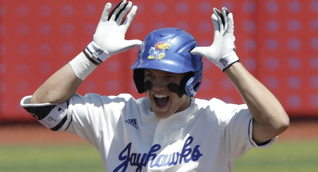 Kansas freshman James Cosentino celebrates a standup double during the Jayhawks' game Saturday, May 13, against the Kansas State Wildcats