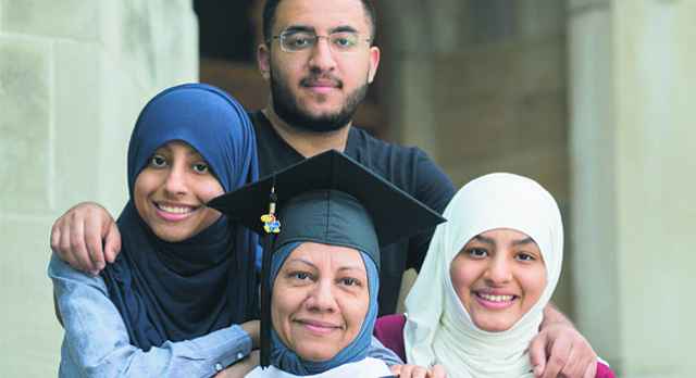 Fatimah Al Ghafli and three of her nine children Ghufran, left, Hassan and Bayan, right, are pictured on Thursday, May 11, 2017 outside Snow Hall on the University of Kansas campus. Fatimah is receiving her master's degree in mathematics this weekend. Ghufran is a sophomore studying pharmacy. Bayan is currently a freshman studying biology. Hassan is studying physical therapy at Washburn University. They are from Saudi Arabia, where the remainder of the family — including several other KU degree holders — currently lives.