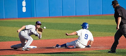 Kansas' James Cosentino (9) slides safely into second base before Kansas State's Jake Wodtke catches the ball during the opener of the Sunflower Showdown Friday night, May 12, 2017, at Hoglund Ballpark.