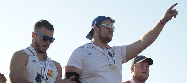 Kansas senior Mitch Cooper holds up the No. 1 after winning the discus throw at the Big 12 Championships on Sunday at Rock Chalk Park. Cooper won the event with a Big 12 record throw of 209 feet, 11 inches. Kansas junior Nicolai Ceban was the runner-up.