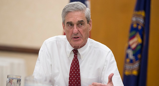 Outgoing FBI director Robert Mueller speaks during an interview at FBI headquarters on Wednesday, Aug. 21, 2013, in Washington. (AP Photo/Evan Vucci)