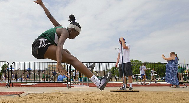 Free State triple jumper Auna Childress crashes into the pit on her final attempt during the 6A Regionals on Thursday, May 18, 2017 at Free State High School.