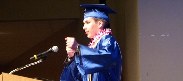 Lawrence Virtual School Class of 2017 valedictorian Dallin Harper illustrates his message that setbacks provide energy for future success to fellow classmates by pretending to draw a bowstring. The school's biggest-ever class of 80 students received diplomas Saturday, May 20, 2017 at Free State High School.