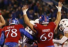 The Jayhawks signal a touchdown by Kansas running back Khalil Herbert (10) during the fourth quarter on Saturday, Nov. 19, 2016 at Memorial Stadium.