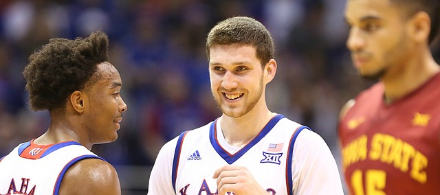 Kansas guard Sviatoslav Mykhailiuk (10) has a laugh with Kansas guard Devonte' Graham (4) during the first half against Iowa State, Saturday, Feb. 4, 2017 at Allen Fieldhouse.