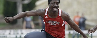Lawrence High School hurdler James Reeder wins the 110 hurdles during the Free State Invitational on Friday at FSHS.