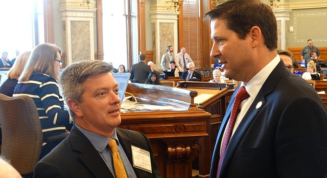 Jeff King, left, a former senator now serving as the Legislature's legal counsel on school finance, confers with House Speaker Ron Ryckman during debate in the House on a new school funding system aimed at satisfying a Kansas Supreme Court decision that declared current funding inadequate and unconstitutional.