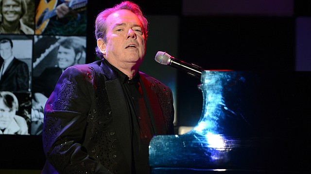 """Jimmy Webb performs at the 22nd annual """"A Night At Sardi's"""" to benefit the Alzheimer's Association at the Beverly Hilton Hotel on Wednesday, March 26, 2014, in Beverly Hills, Calif. (Photo by Jordan Strauss/Invision for Alzheimer's Association/AP Images)"""