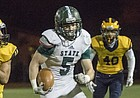 Free State senior running back Sam Skwarlo (5) outruns Wichita Northwest senior defensive back Justin Onwugbufor (14) on his way to a touchdown during their game Friday night in Wichita.